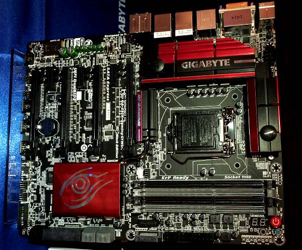 G1 Gaming boards now have a new Red/Black livery. Notice the green Nichicon audio caps to the top left and the water block heatsinks around the MOSFETs.
