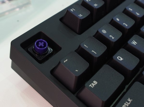 Cooler Master's own Hybrid Capacitive switch is compatible with Cherry MX key caps too.