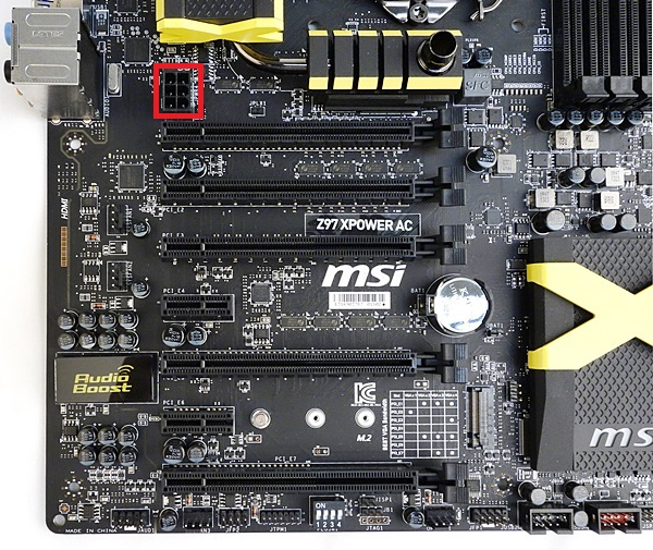 There is a 12V 6-pin ATX power connector (marked in with red frame) located near the first x16 slot; however, it isn't indicated if it provides additional power for a multi-GPU setup.