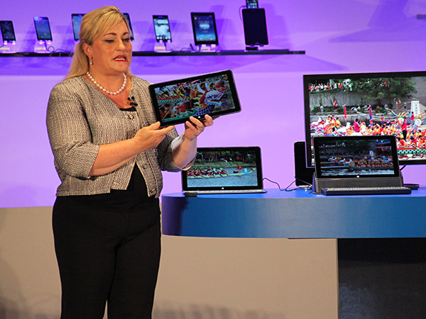 "Intel corporation president Renee James with the world's first fanless mobile PC reference design based on the 14nm Broadwell processor. The reference product is a 12.5"" screen that is 7.2mm thin with keyboard detached and weighs 670 grams. The innovative design is based on a purpose-built for processor for 2-in-1s and will be in market later this year. Called the Intel Core M processor, it will deliver the most energy efficient Core processor in the company's history."