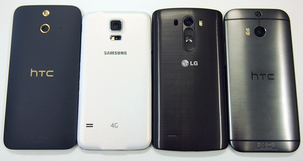 The rear view of the phones. <br>From left to right: HTC One (E8), Samsung Galaxy S5, LG G3, HTC One (M8).