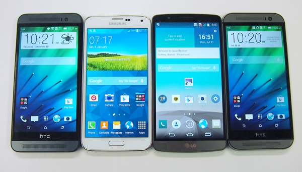The front view of the phones. <br>From left to right: HTC One (E8), Samsung Galaxy S5, LG G3, HTC One (M8).
