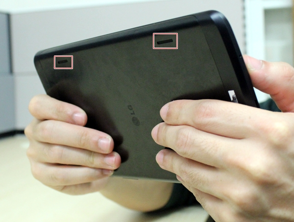 While the stereo speakers are not blocked by the hands, audio output is directed away from you on the LG G Tablet 8.3.
