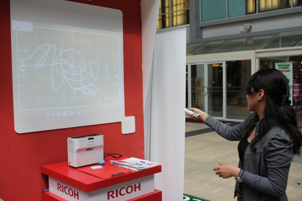 Write in mid-air and it will appear on the display with Ricoh's new short throw projectors.