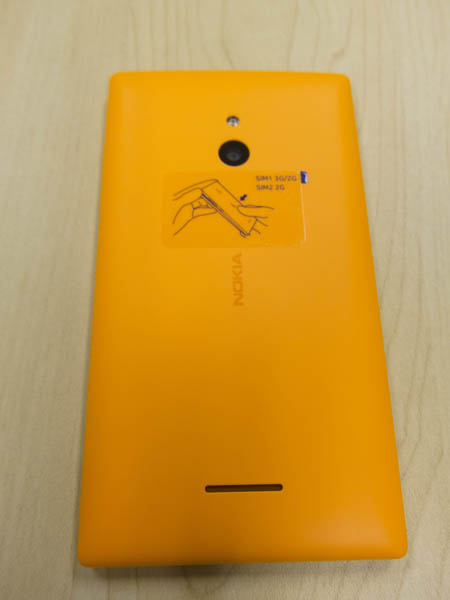 The colourful orange back cover