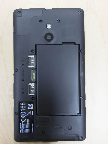 Underneath the Nokia XL, you can see the removable battery, dual SIM slots and a microSD card slot.