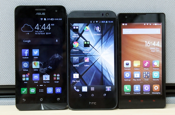 The front-facing shot of the three phones. <br> Left to right: ASUS ZenFone 5, HTC Desire 616 and Xiaomi Redmi 1S.