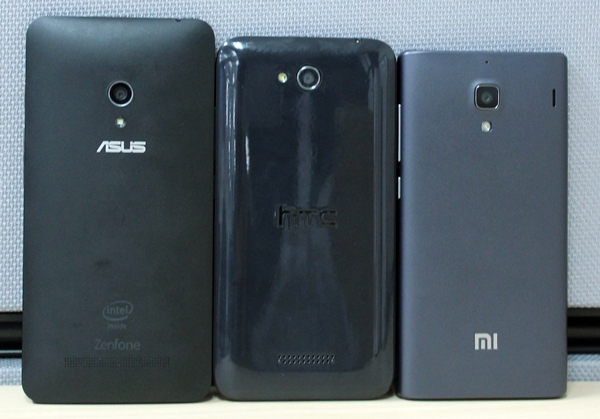 The rear shot of the three phones. <br> Left to right: ASUS ZenFone 5, HTC Desire 616 and Xiaomi Redmi 1S.