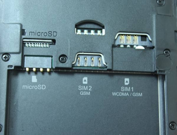From L-R: microSD memory card slot, micro-SIM card slot and regular-sized SIM card slot. Only SIM slot 1 supports 3G data connectivity; slot 2 only supports 2G data connection.