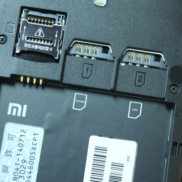 From left to right: microSD memory card slot and two regular-sized SIM card slots.