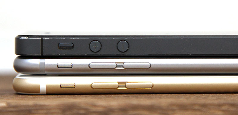 Despite being just 5 and 7mm thicker, the iPhone 5 (top) looks massive lying on top of the iPhone 6 (middle) and 6 Plus (bottom).