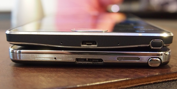 Comparing the bottom side of the devices. You will notice there is no micro-USB 3.0 port on the Samsung Galaxy Note 4 (top).