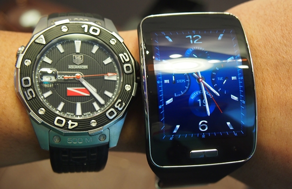The Samsung Gear S seen beside a conventional watch.