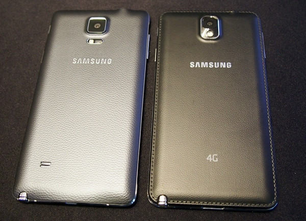 Both devices sport the same soft-textured back covers. <br> Left: Samsung Galaxy Note 4. Right: Samsung Galaxy Note 3.