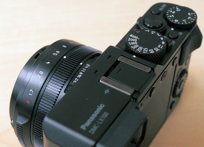 There's a dedicated shutter speed dial, another dial for exposure compensation and a ring on the lens to set aperture.