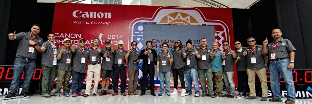 Canon Crusaders of Light and the Canon Executives. (9th from L) Mr. Lim Kok Hin, President & CEO of Canon Marketing Philippines