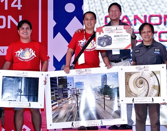 The winners from the DSLR / Interchangeable Lens Category. (From L to R) 1st Runner Up, Creze Elma; Grand Prize Winner, Jerome Duenas ; Vinchy Sanchez Asst. Director, Canon; Winning Entry of 2nd Runner Up Elizer Magno held by Richard Ordonez of Canon