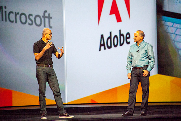 Microsoft CEO, Satya Nadella (left), made a special appearance at Adobe MAX 2014 to talk about Microsoft's support for touch in Windows. Joining him on stage is Adobe's CEO, Shantanu Narayen (right).