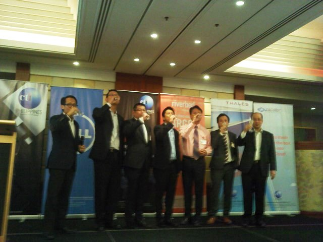 Executives make a toast at the opening of Computrade Technology Philippines, Inc. at the Makati Shangri-La Hotel.
