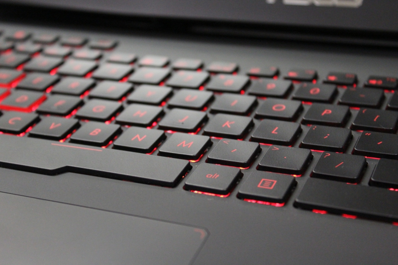 A close up of the keyboard keys shows the red backlight as well as how the trackpad is set into the base itself.