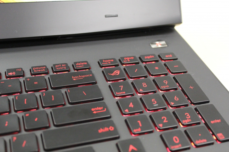 The ROG button's on the opposite end of the Steam button, nestled where the Numlock key usually is on a normal keyboard. Meanwhile, the Numlock has been shifted up and shares a home with the Home button.