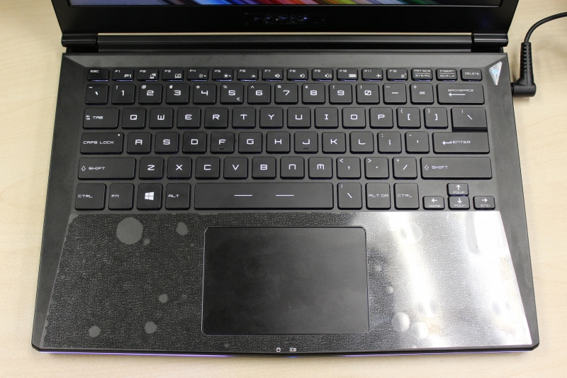 Looking down from the top, you can't really tell the keyboard's backlighted, unless you look closely under the Function keys on top. It's still visible in the dark though.