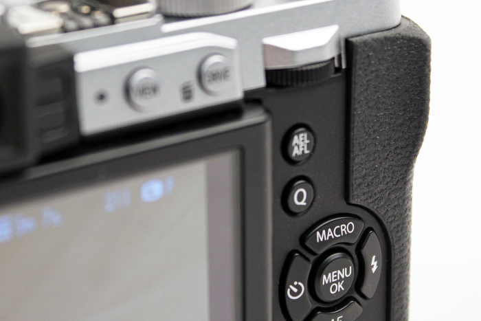 The Q buttons is a shortcut to various shooting settings.