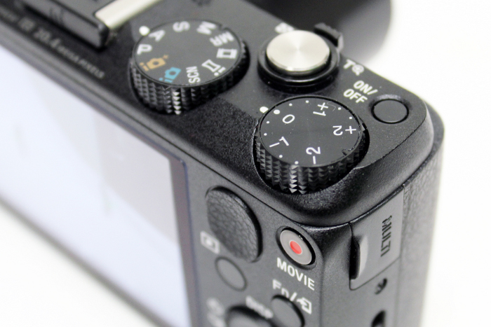 The HX60V comes with a dedicated exposure compensation dial. Just don't forget to set it back to 'zero' when you're done.