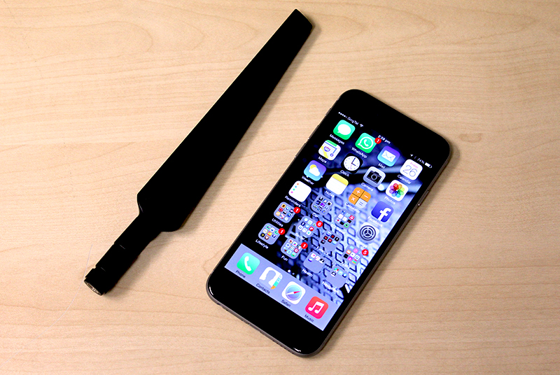 Look at what big antennas you have. Here is the Nighthawk X4's antenna next to an iPhone 6.