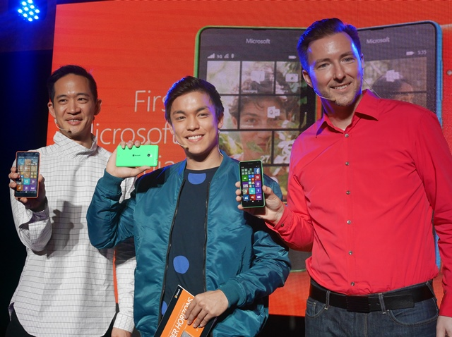 Microsoft executives, together with the host of the event, pose with the newly-launched Lumia devices.