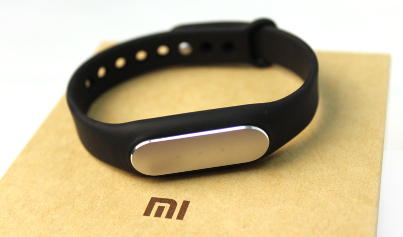 The Mi Band has a sleek aluminum top and comes with a simple but comfortable black rubber wristband.
