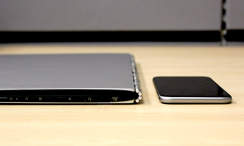 The Yoga 3 Pro is just 12.8mm thick. Not very much thicker than the new iPhone 6.