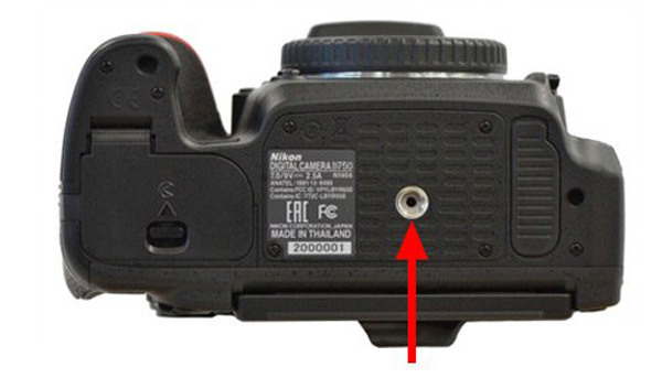 A dot at the tripod socket will indicate if your camera has already been serviced.