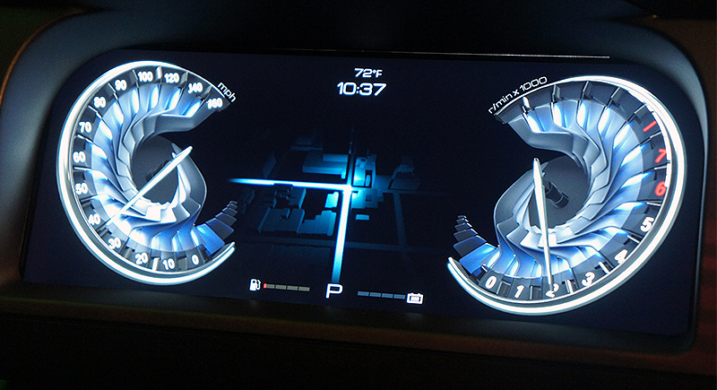 A close look at a dashboard powered by the Drive CX. Those are 3D meters with ambient lighting effects that reacts with the counter as it sweeps across the dial.