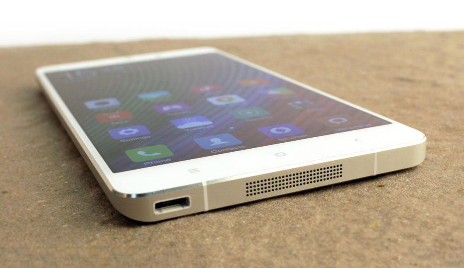 The micro-USB port and speaker grille can be found at the bottom of the device.