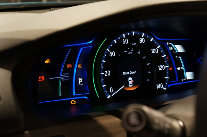 Checking the retrofitted Honda Odyssey's main dashboard, we noticed there's a battery power gauge along with a fuel gauge for conventional drive.