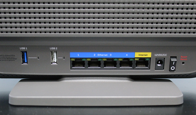 Users can find the usual assortments of ports behind the router. We liked that the two USB ports are spaced wide apart, which makes it easier to connect (and disconnect) devices. Note also the LED indicators on the Gigabit and USB ports.