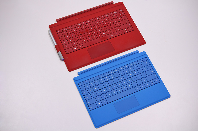 The Type Cover for Surface 3 (the one in blue), while smaller than the Type Cover for Surface Pro 3, still manages to pack a full-size keyboard with backlit keys.