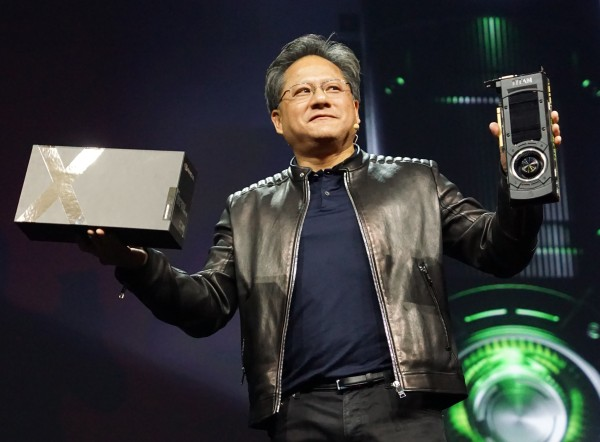 Jen-Hsun holding up the GeForce GTX TITAN X, the world's fastest GPU.