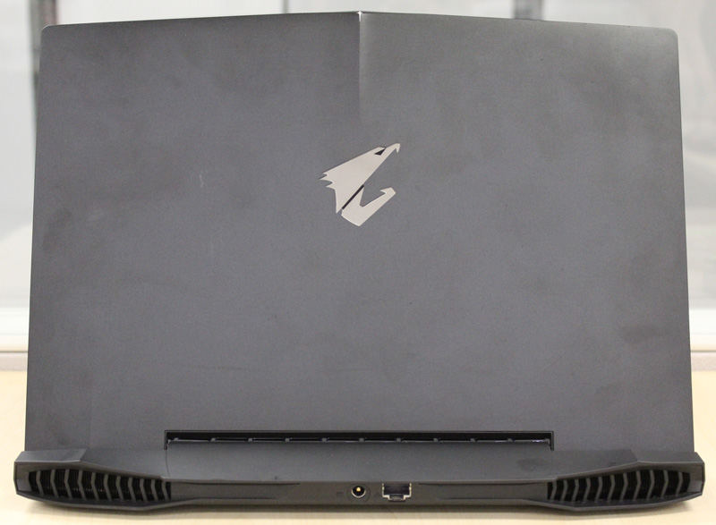 Despite the machine's slim dimensions, it has a full-sized Ethernet port at the rear. Note also the large exhaust vents on both ends for cooling.