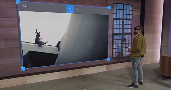 Holograms are basically Windows 10 universal apps, so you can resize them.