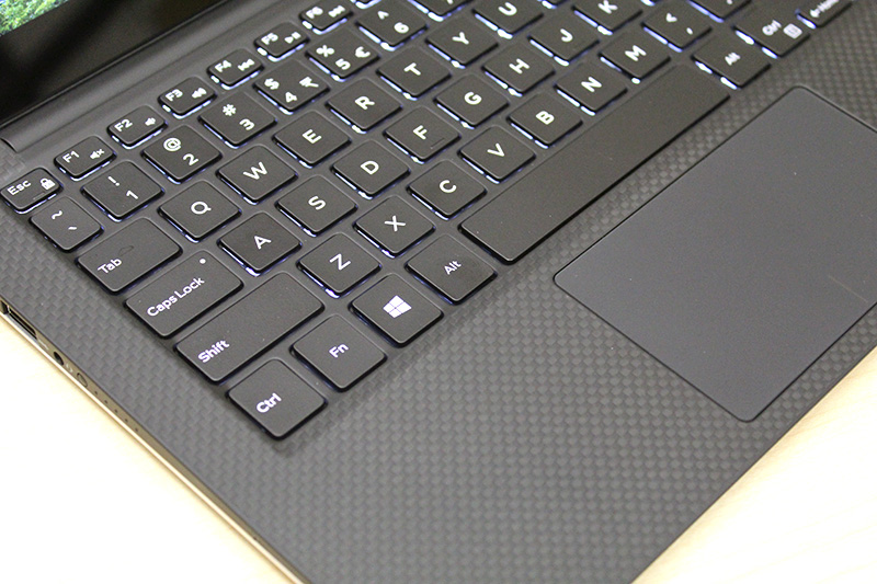 The keyboard panel is made out of carbon fiber and is coated with soft touch paint, giving it an almost rubbery feel.