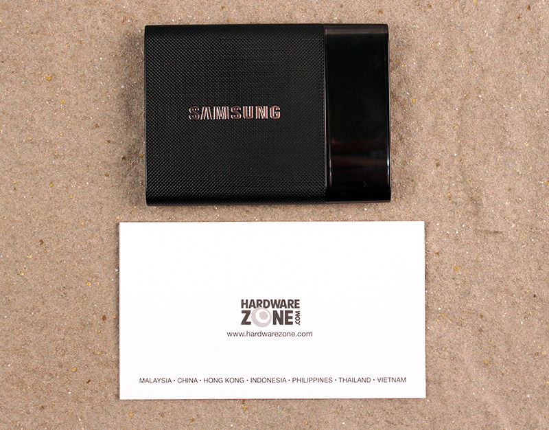 The Samsung Portable SSD T1 is incredibly small. Here it is next to a name card.