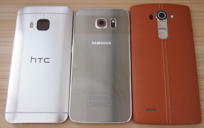 From left to right: HTC One M9, Samsung Galaxy S6, LG G4. <br> Metal, glass, leather - what's your pick?