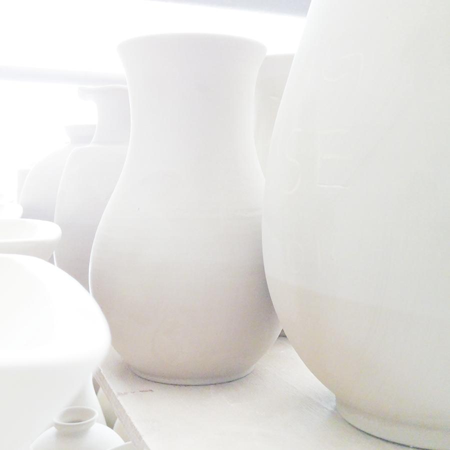 Backlit ceramics, 28mm at f/1.8, 1/25 sec, ISO 350.