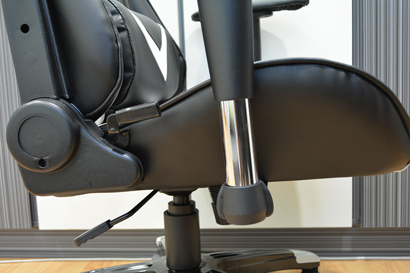 The height adjustment lever is located at the right side of the chair and angled toward the back.