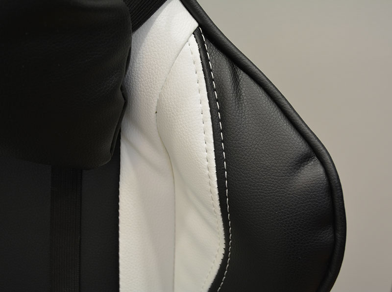 A close-up shot of the PU leather on the Throne, which also features white stitching that matches the color of the chair.