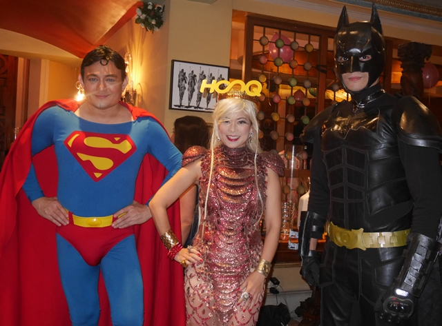 In the middle is Tessa Prieto-Valdes with her Superman- and Batman-costumed friends.