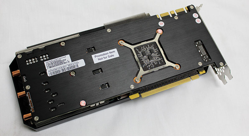 The card's backplate includes a GPU cutout with an additional reinforcement plate for the GPU.