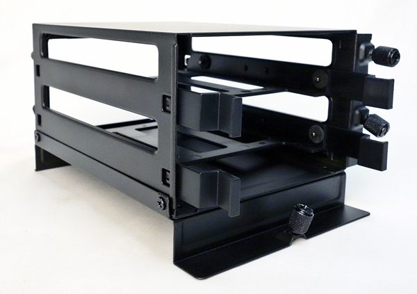 The drive cage is installed from the front of the tray, and secured with three mounting screws.